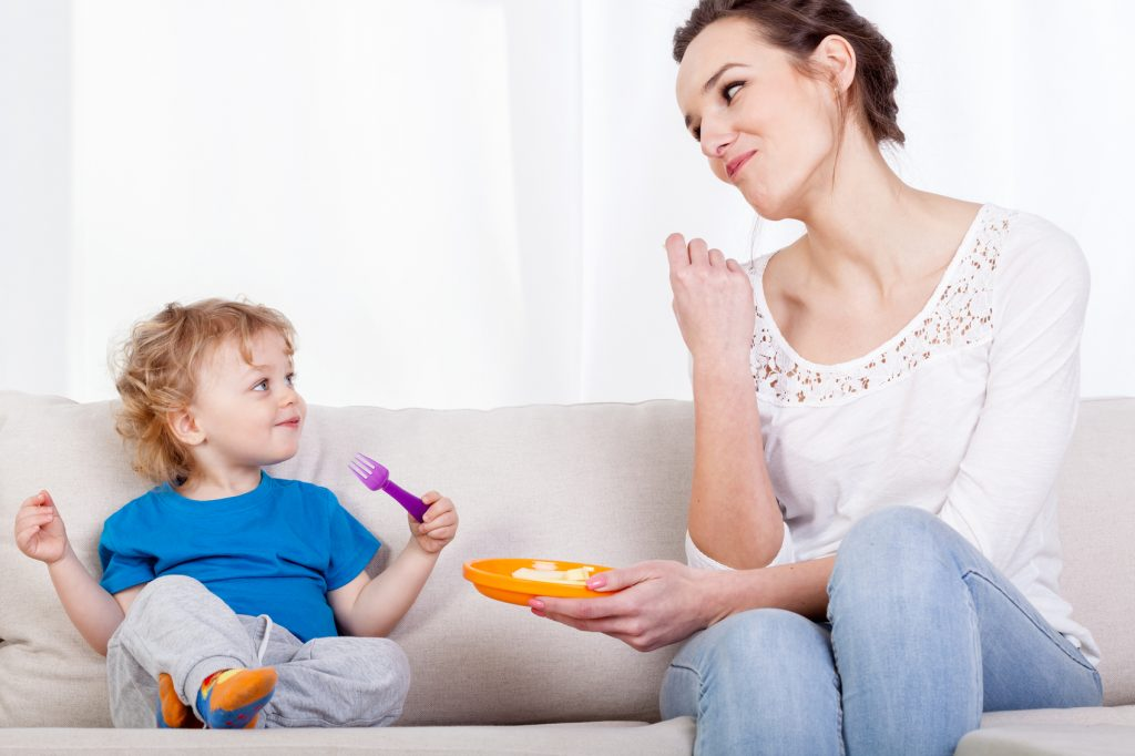 Mum and child eating meal together, horizontal